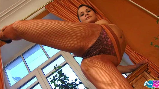Sexy flexible girl in bodysuit and pantyhose demonstrates her sumptuous body and nasty skills